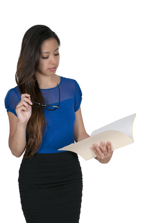 paralegal: Beautiful young woman lawyer or business woman holding a manila file folder