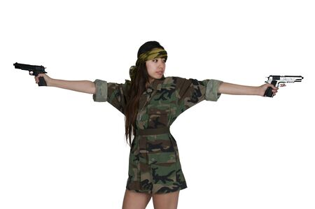Beautiful young Asian woman soldier with a gun Stock Photo