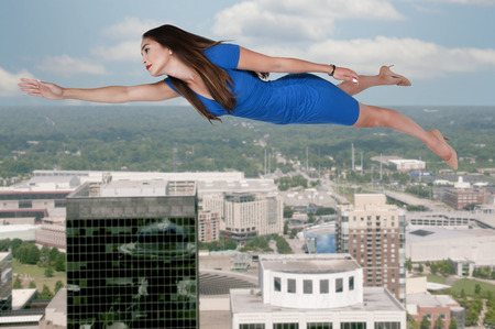 wican: Beautiful young woman floating or flying in the air