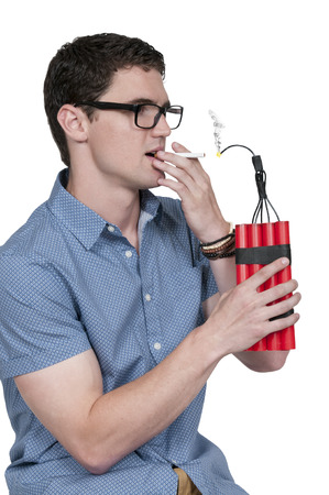 human time bomb: Handsome mman lighting a cigarette with dynamite Stock Photo