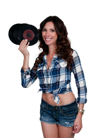 45: Beautiful woman with vintage 45 vinyl records Stock Photo