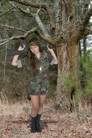female assassin: Beautiful young woman soldier with a M16 rifle