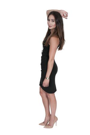 mujer sexy: Mujer atractiva joven hermosa en un vestido negro y tacones altos