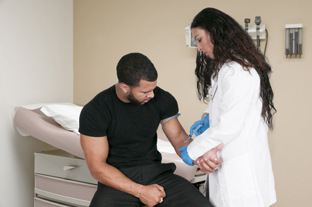 Woman doctor explaining a prognosis to a man patient Stock Photo - 42863766