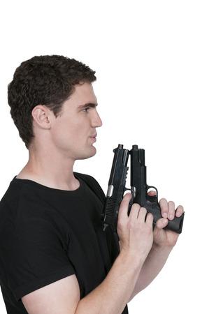 hand gun: Handsome young man holding a hand gun pistol Stock Photo