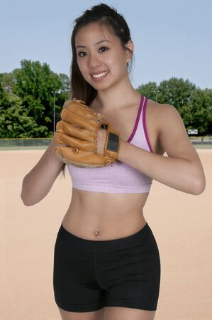 pitchers mound: Beautiful woman baseball pitcher getting ready to throw a ball in a game