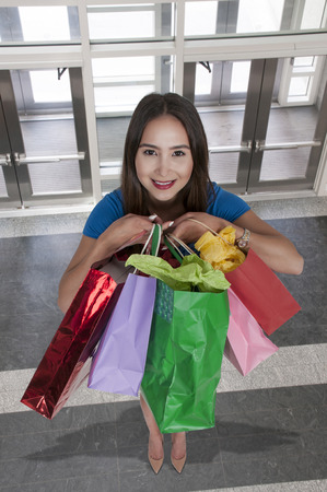 shopping spree: Beautiful young woman on a shopping spree Stock Photo