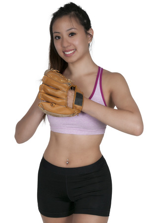 baseball pitcher: Beautiful woman baseball pitcher getting ready to throw a ball in a game