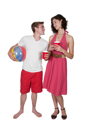beachball: Young couple drinking out of cups at the beach