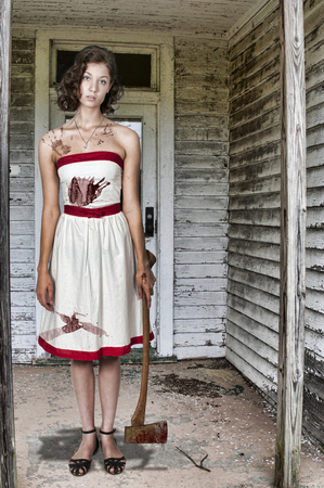 possessed: Beautiful possessed woman in a trace holding an axe Stock Photo