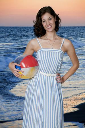 beachball: Beautiful young woman holding a beach ball Stock Photo