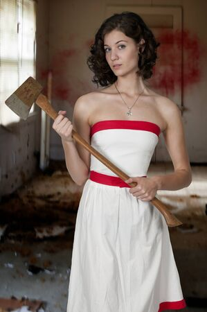 scarry: Beautiful possessed woman in a trance holding an axe
