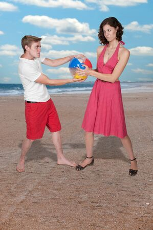 beachball: Young couple playing with a beach ball