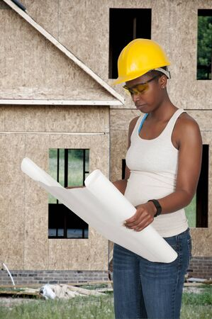 ppe: Female Construction Worker on a job site