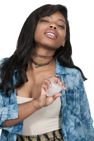 unemotional: Woman holding a heart made of ice Stock Photo