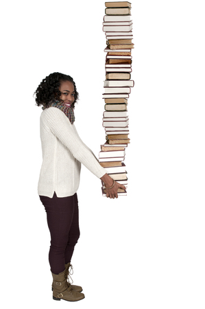Beautiful woman holding a stack of library books 版權商用圖片