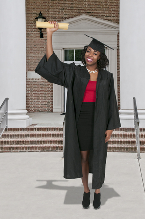 academic robe: Young black african American woman in her graduation robes
