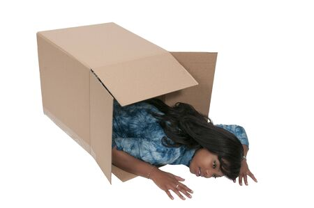 thinking outside the box: Beautiful woman thinking outside of the box