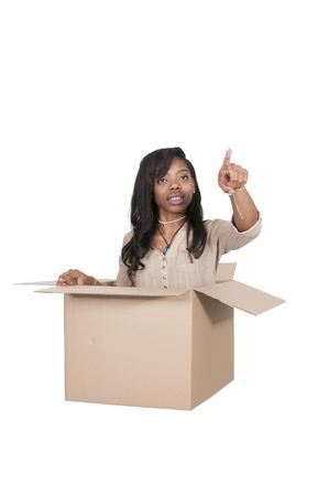 outside the box: Beautiful woman thinking outside of the box