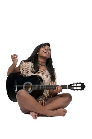 girl playing guitar: Beautiful young woman playing an acoustic guitar