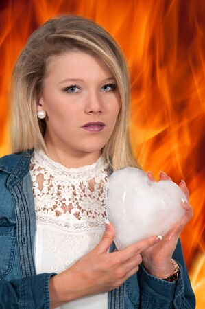 cold blooded: Woman holding a heart made of ice Stock Photo