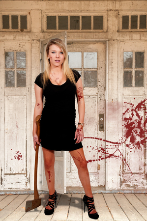 possessed: Beautiful possessed woman in a trance holding an axe