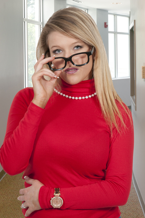 bothered: Woman deep in thought holding her glasses