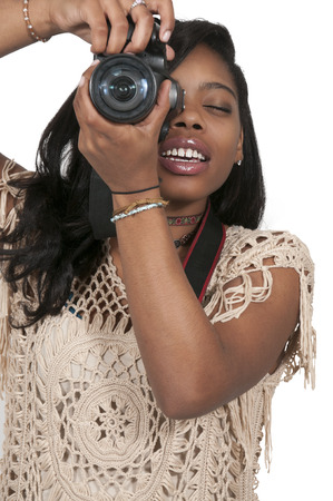 dslr: Young woman photogapher with her dslr camera