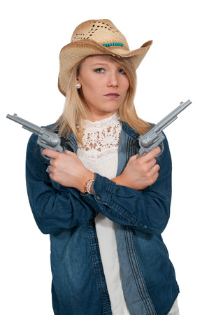 six shooter: Beautiful young country girl woman wearing a stylish cowboy hat and revolvers