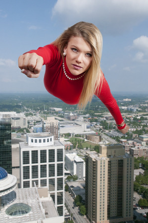 supergirl: Beautiful young woman flying through the sky