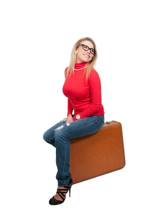 hot chick: Beautiful young woman wearing glasses going on vacation with a suitcase