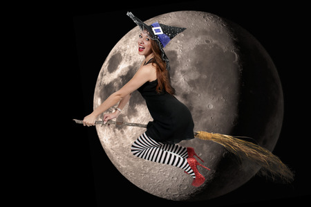 wicked woman: Beautiful woman wicked witch with ruby shoes flying by a NASA moon Stock Photo