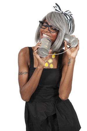 tin can phone: Woman talking on a primitive tin can phone