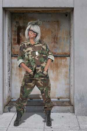 camouflage woman: Beautiful young woman soldier in camouflage