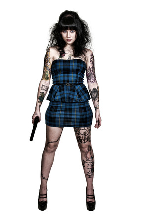 Beautiful young tattooed woman with a pistol photo