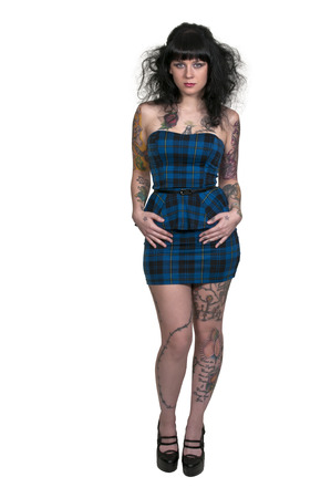Beautiful young sexy tattooed woman in a dress and heels photo