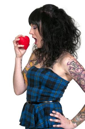 Beautiful woman eating a big red heart photo