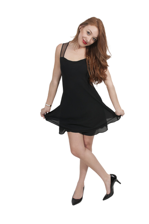 stilleto: Beautiful young sexy woman in a little black dress and high heels Stock Photo