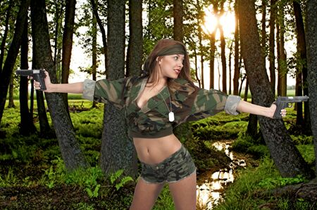 pistols: Gun toting beautiful young woman soldier with pistols