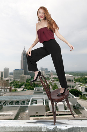 antique chair: Beautiful woman standing on a antique chair