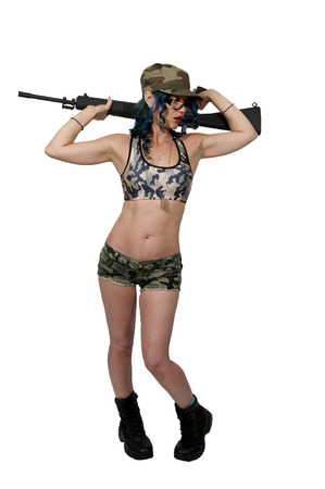assault rifle: Beautiful young woman soldier with an assault rifle