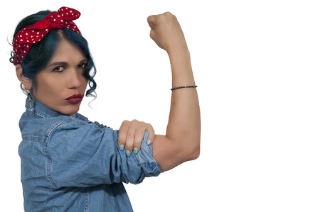 feminist: Beautiful woman dressed as the iconic Rosie the Riveter