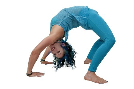 Beautiful woman practicing a back bend yoga position Stock Photo