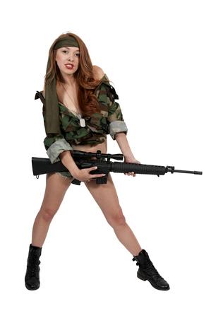 assault rifle: Beautiful young woman holding an automatic assault rifle