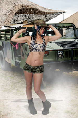 assault: Beautiful young woman soldier with an assault rifle