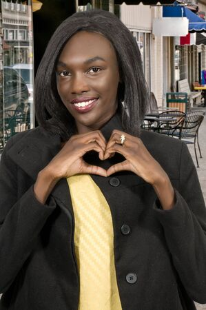 Beautiful woman making a heart shape with her hands