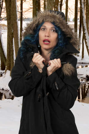 flurry: Beautiful woman wearing her winter coat with a hood Stock Photo