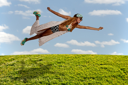 supergirl: Beautiful young woman flying or falling through the air