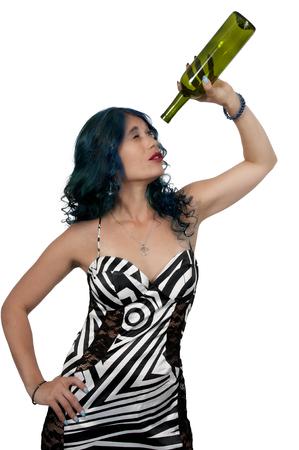 Beautiful woman holding an empty bottle of wine