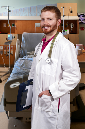 labcoat: Young male doctor waiting to go on rounds